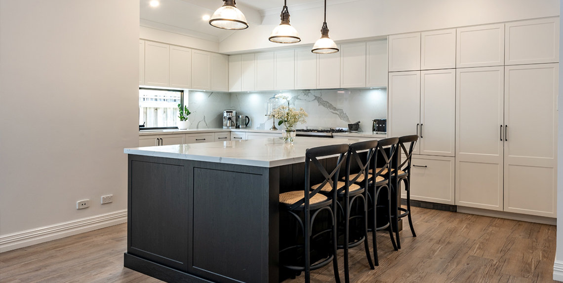 Black and white island kitchen with a white kitchen background.